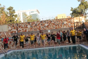 Last day ritual. Everyone in the pool. We had all given our sponsors T-shirts to hospital staff and bought Ugandan Football tops.
